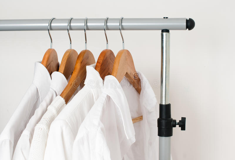 White clean clothes, shirts and jackets stock photo