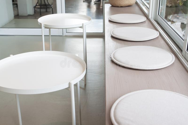 White clean simple and modern style table and seats in modern cafe or restaurant royalty free stock images