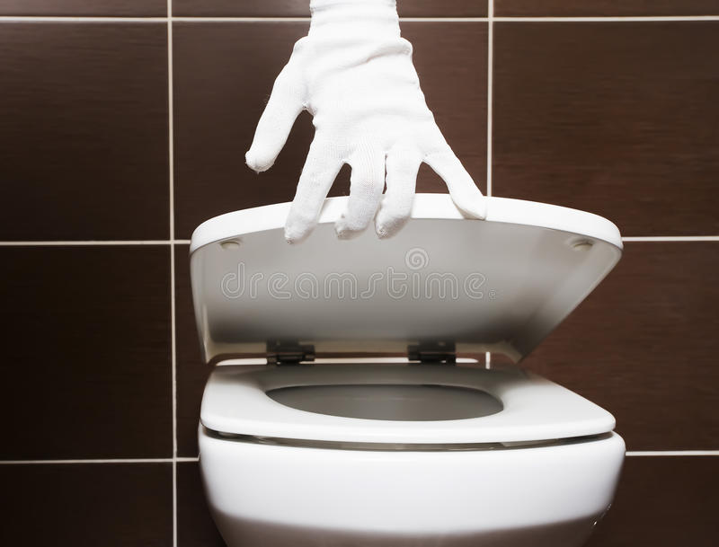 White clean toilet with open seat cover stock photos
