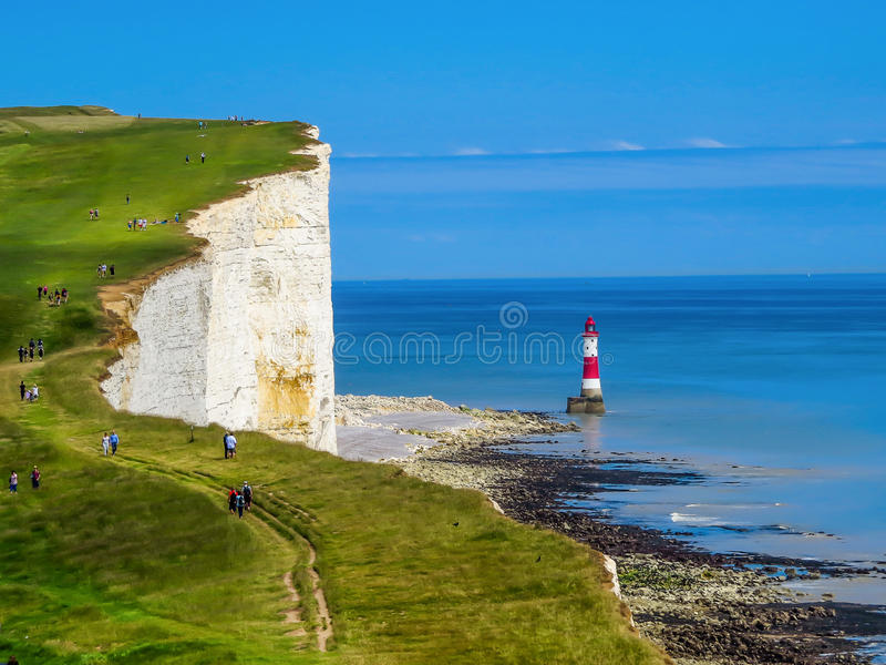White cliffs and Beachy Head lighthouse. White cliffs and lighthouse. Eastbourne, East Sussex, England (UK royalty free stock image