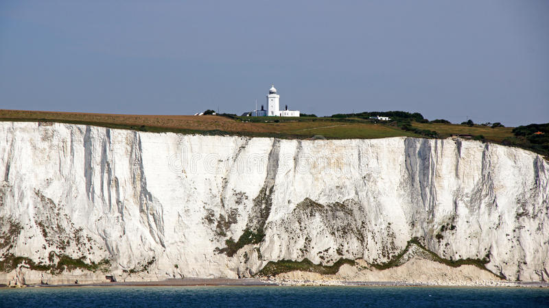 White cliffs of Dover and lighthouse royalty free stock photo