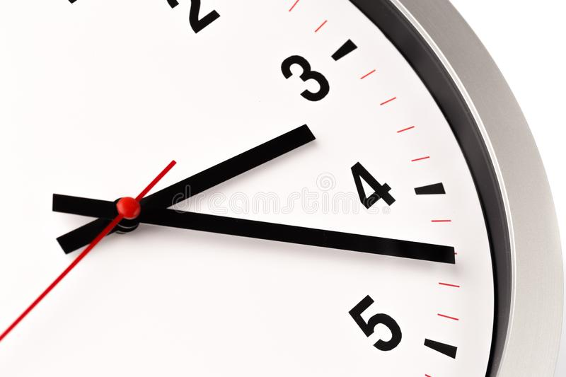 White clock, close up view stock photography