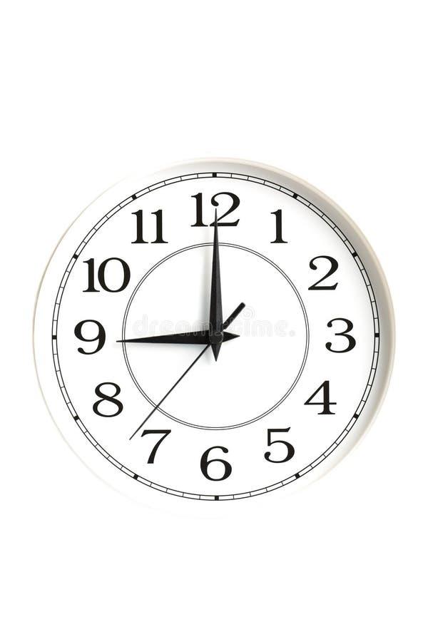 White clock showing nine o'clock isolated royalty free stock image