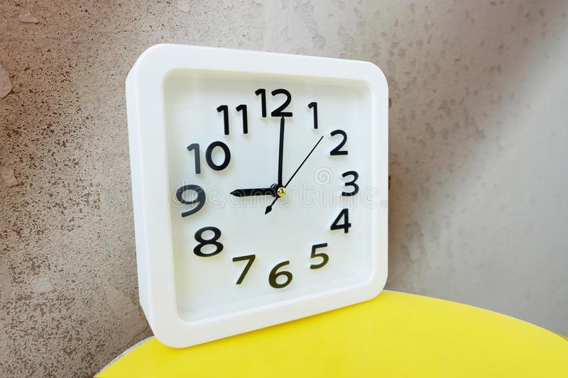 White Clock . Time Nine Alarm Clock on Old Brown Crack Wall Background stock photos