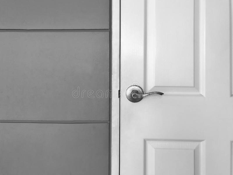 White close wooden door and gray wall, black and white tone stock images