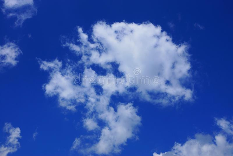 White cloud on blue day sky. Big white cloud on blue day sky stock photo