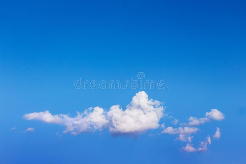 White cloud on blue sky background below. Copy space_. White cloud on blue sky background below. Copy space royalty free stock photos