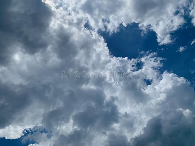 A white cloud on blue sky or a cumulonimbus on the sky as natural background. Design stock photography