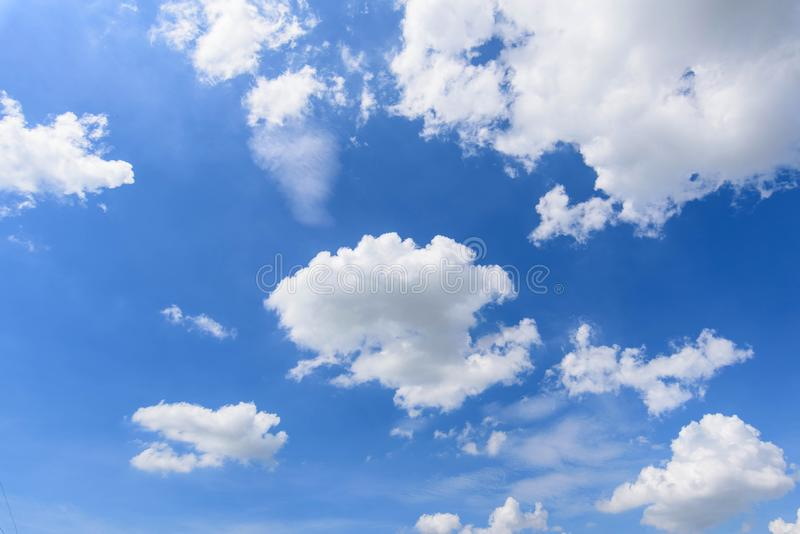 White cloud disappear in the hot sun. On blue sky stock photo
