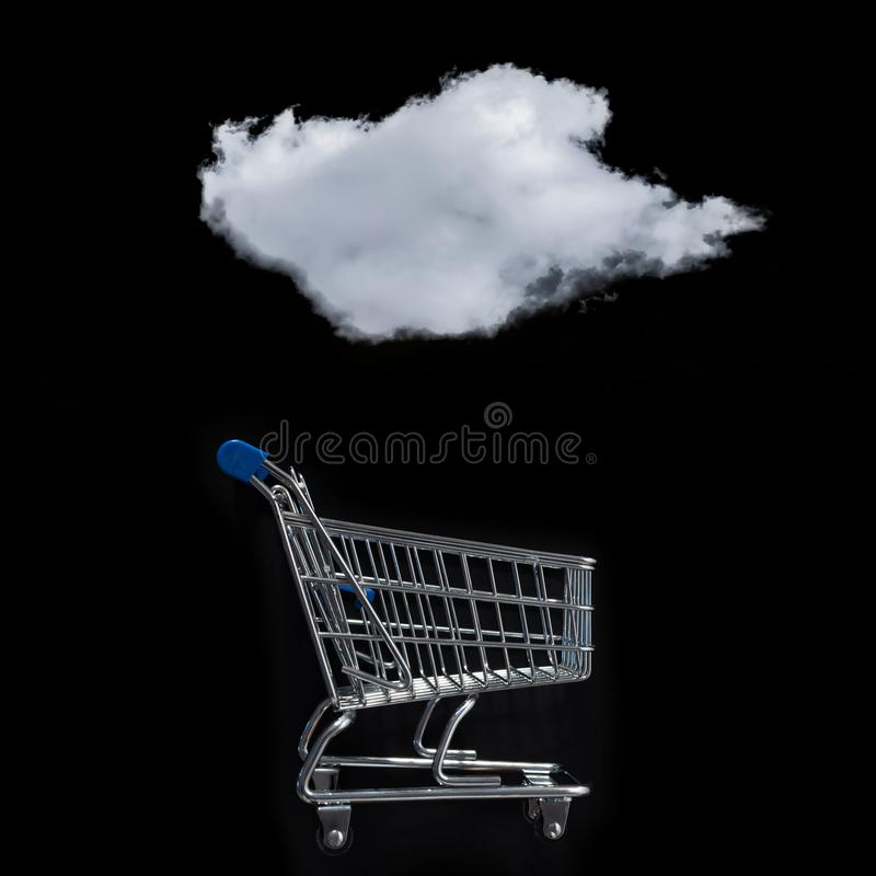 White cloud over of the shopping cart against the black background royalty free stock images