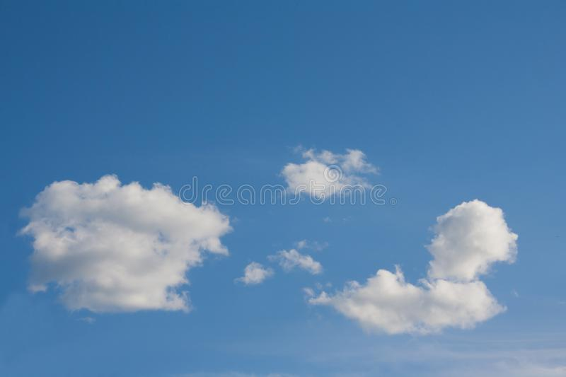 White cloud in shape of sphinx against blue sky sunny day. Background royalty free stock photography