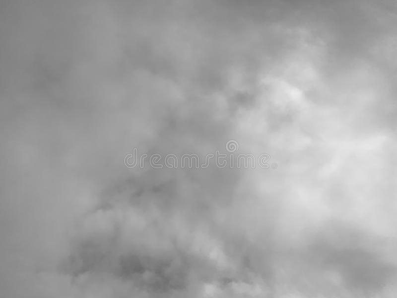 A white cloud on the sky, black and white tone. Background stock images