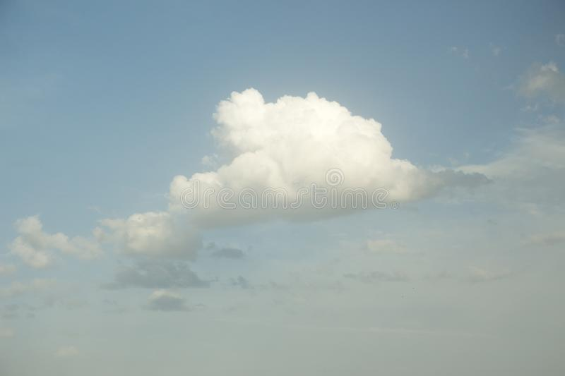 White cloud in the soft blue sky. Dramatic sky background. royalty free stock images