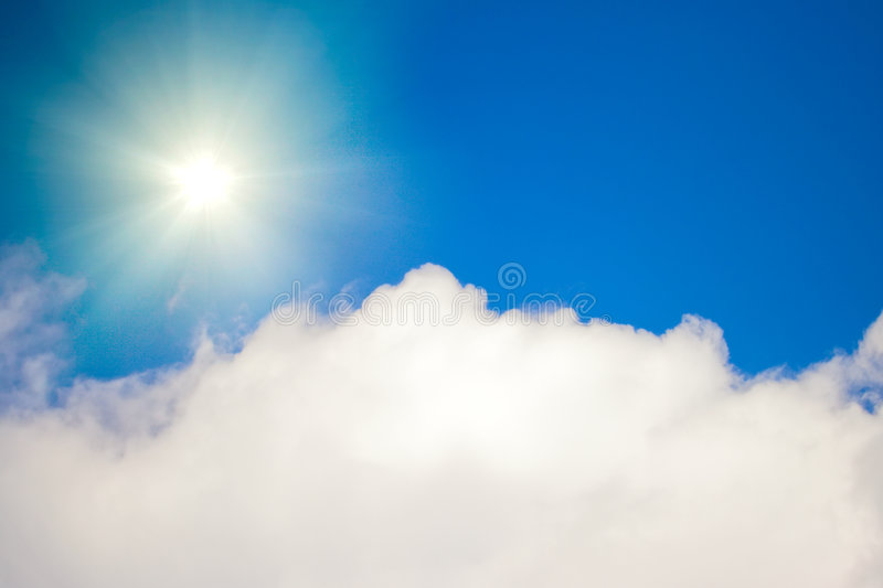 White cloud with sun in the sky. Fluffy white cloud with sun in the sky stock photography