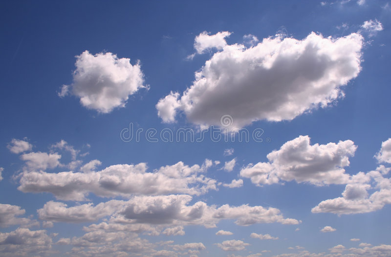 White clouds. On the blue sky royalty free stock image