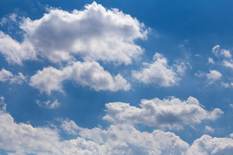 White clouds against a blue sky.  Beautiful weather royalty free stock image