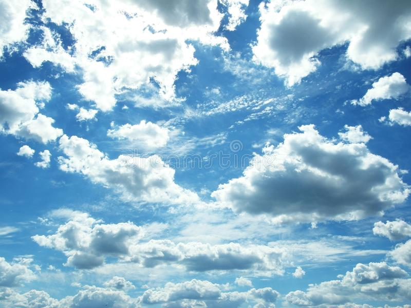 White clouds against a blue sky royalty free stock photo