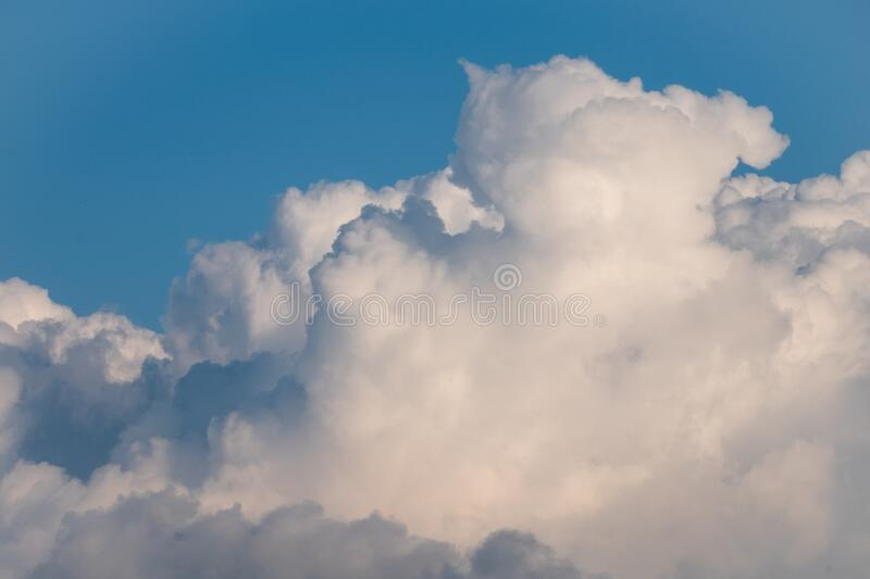 White bank of cloud against blue summer sky royalty free stock image