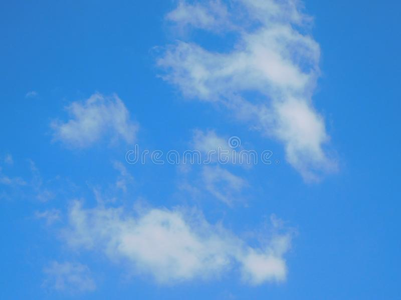 White clouds in the beautiful blue sky. Wallpaper template, background, textures royalty free stock images