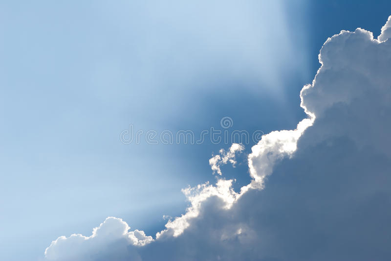 White clouds on blue sky. Sunshine tru beautiful white clouds on blue sky background stock photography
