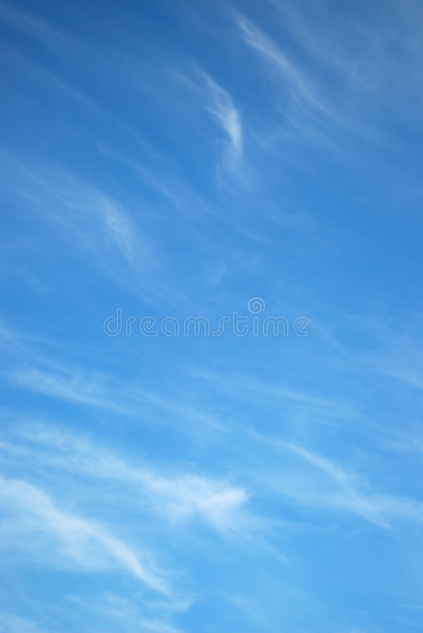 White clouds in a blue sky royalty free stock image