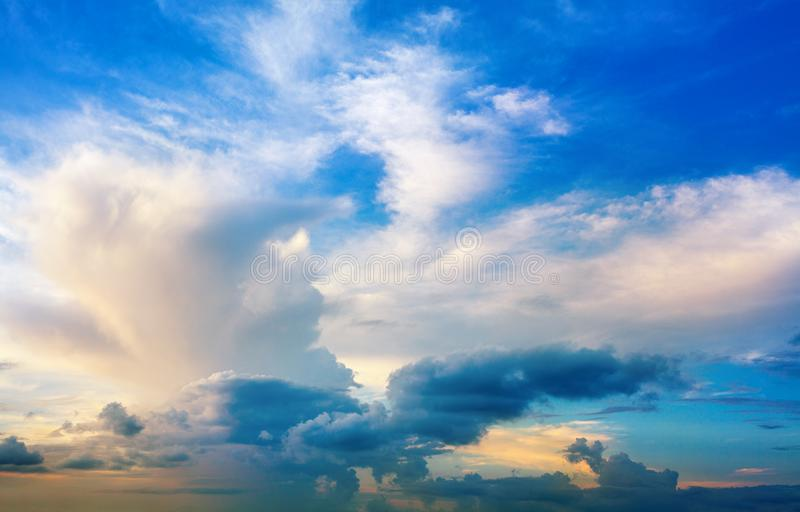 White clouds on blue sky background close up, colorful sunrise cloudy skies, beautiful azure and yellow cloudiness heaven sunseT stock image