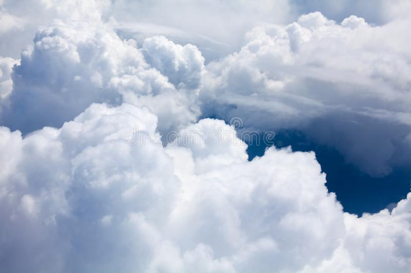 White clouds on blue sky background close up, cumulus clouds high in azure skies, beautiful aerial cloudscape view from above stock photo