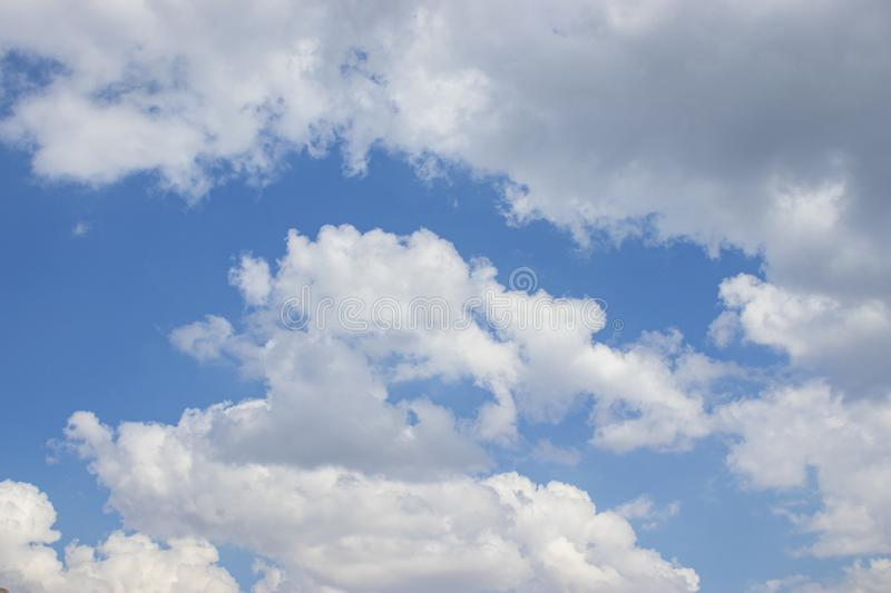 White clouds blue sky background, natural texture. White clouds, sky background, natural texture royalty free stock images