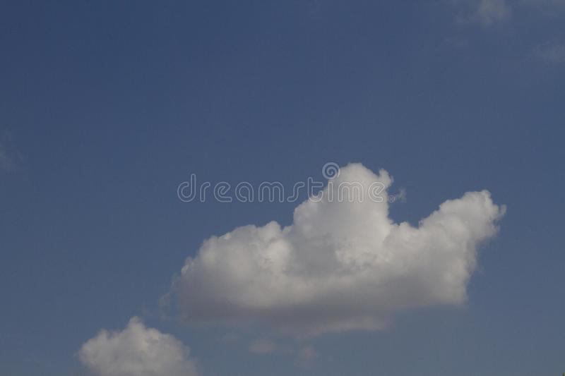 White clouds and blue sky. Spring, blue sky and white clouds above the city. Capitol Ankara, Turkey royalty free stock image