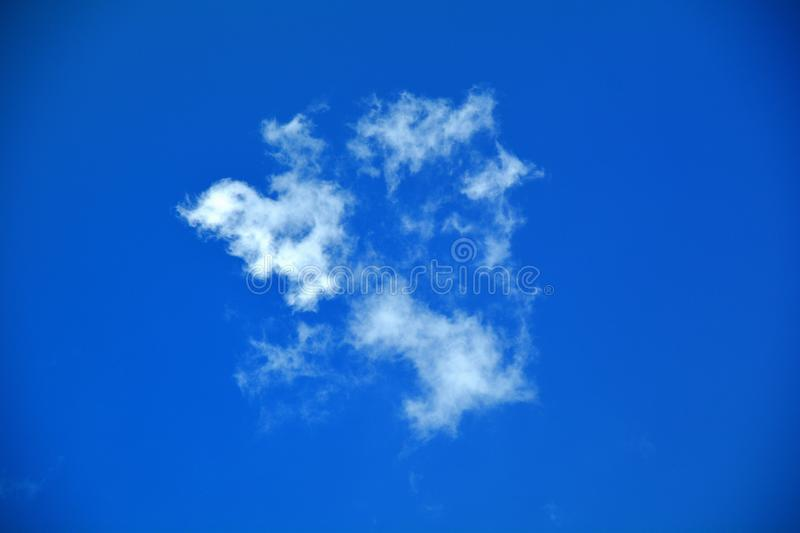 White clouds in the blue sky. stock photography