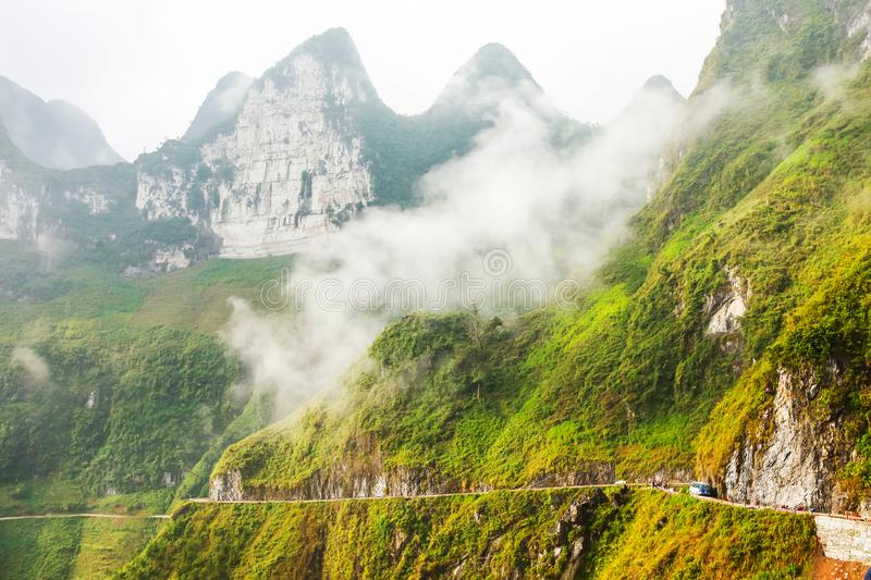 White clouds cover the mountains rocky Global Geopark in Ha Giang, Vietnam.  stock photo
