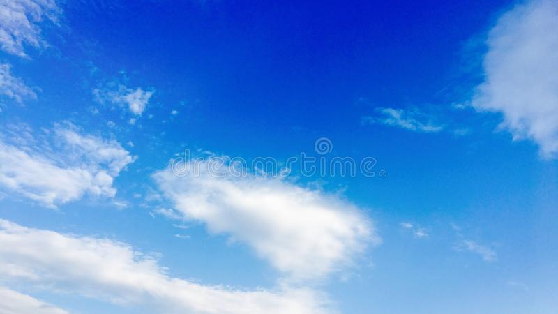 White clouds disappear in the hot sun on blue sky. Clouds. Blue sky. White clouds disappear in the hot sun on blue sky. White Clouds. Blue sky royalty free stock photo