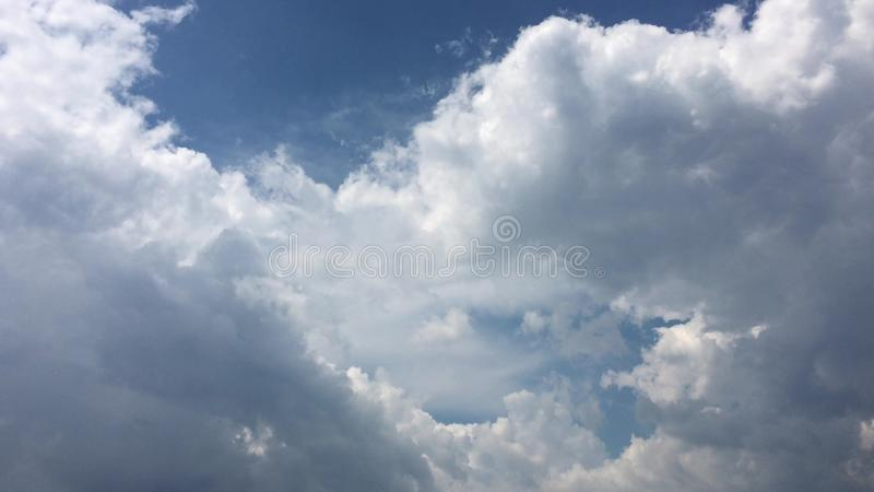 White clouds disappear in the hot sun on blue sky. Motion white clouds blue sky background.  stock photos