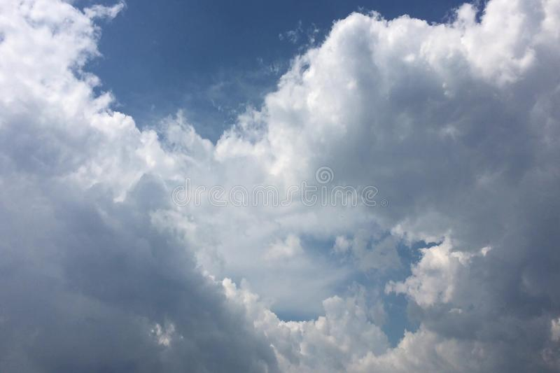 White clouds disappear in the hot sun on blue sky. Motion white clouds blue sky background.  royalty free stock photos