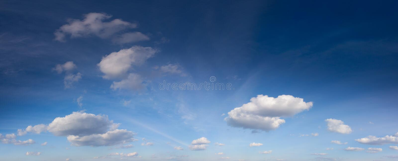 White clouds in the fantastic blue sky. stock images