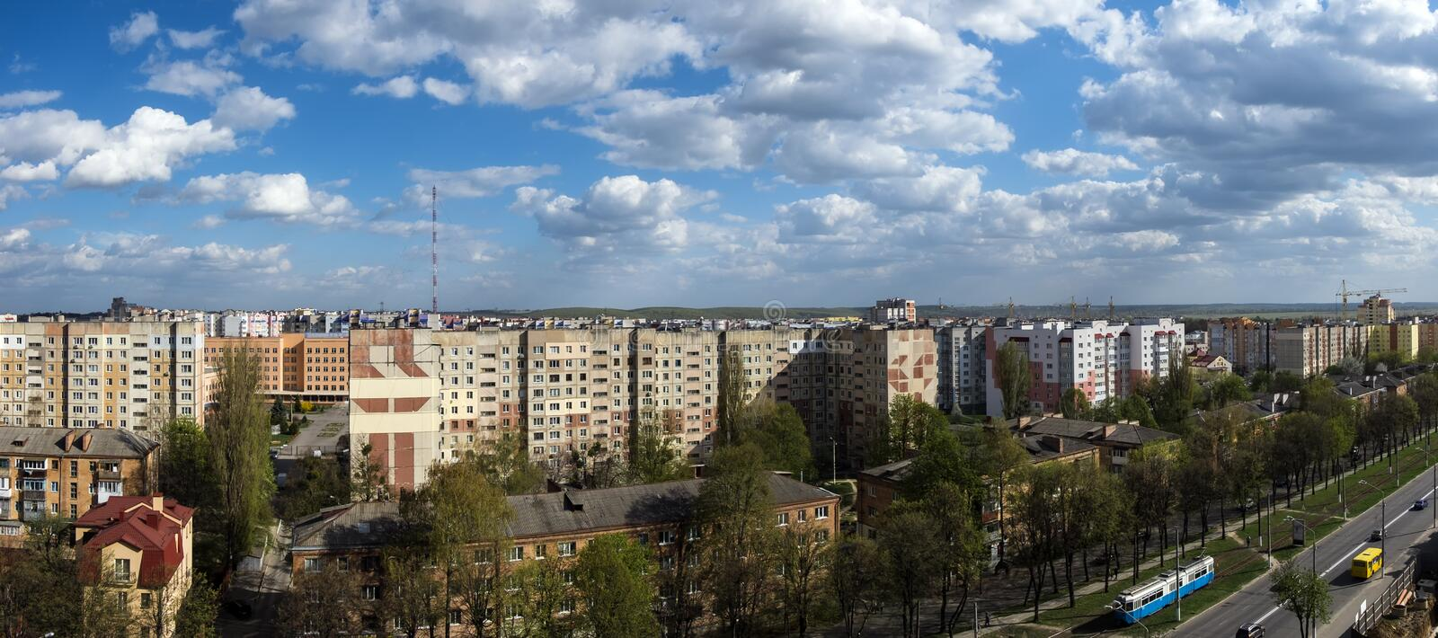 White clouds float above the city. Panoramic cityscape stock photography