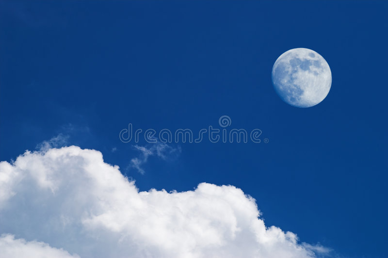 White clouds and full moon. Over deep blue sky royalty free stock photography