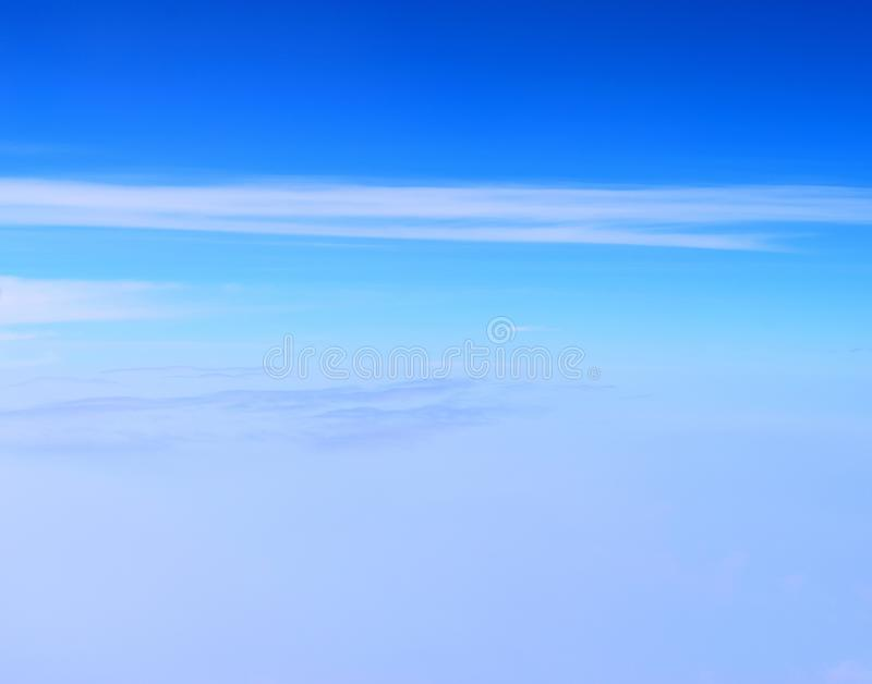 White Clouds in Infinite Sky with Hues of Blue - Abstract Natural Background - Altostratus, Cirrus, and Cirrocumulus Clouds stock photography