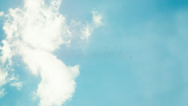 White clouds on the light blue color sky background. 16:9 panoramic format. Copy space stock image
