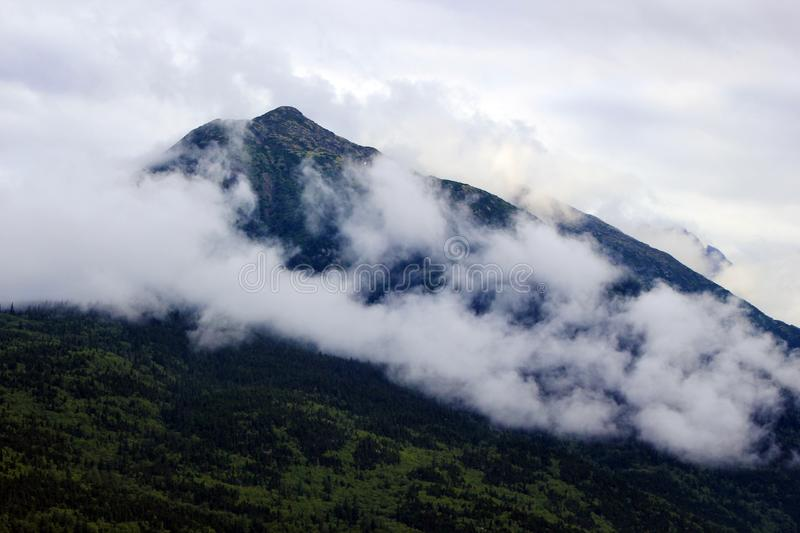 White Clouds over Black Mountain stock photo