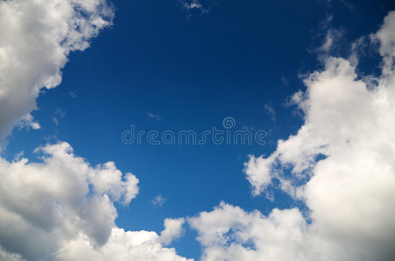 White clouds over blue sky stock image