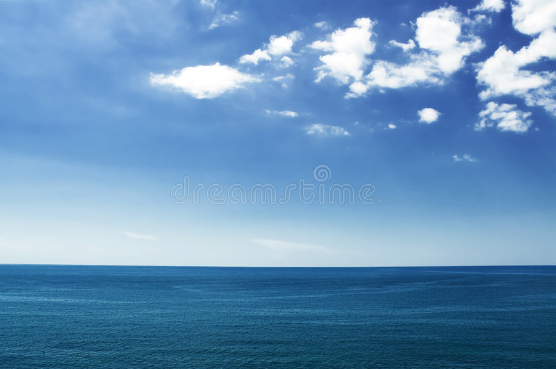 White clouds over the sea royalty free stock images