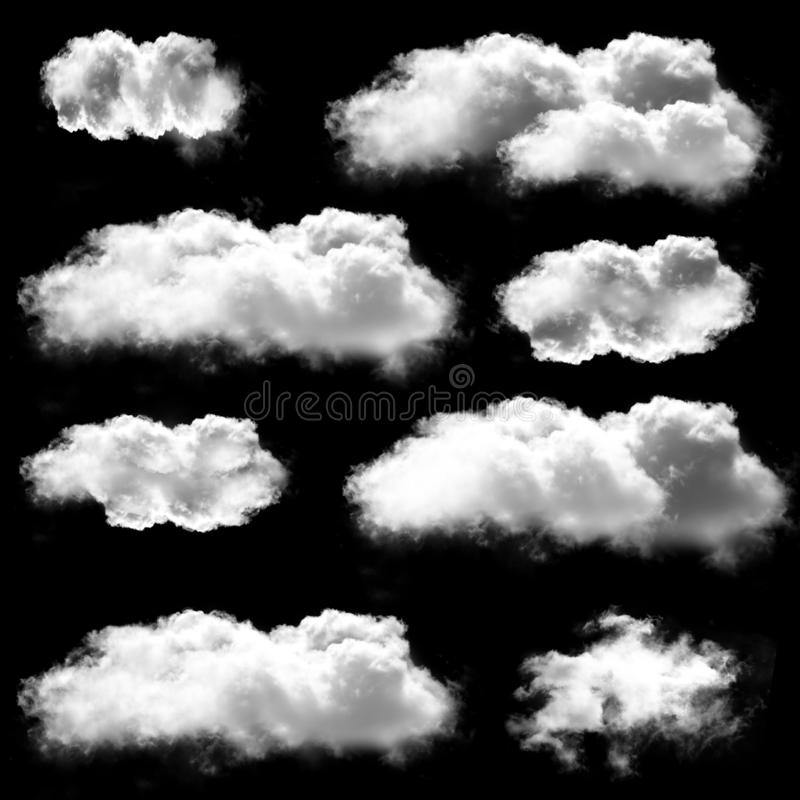 White clouds shapes isolated over black background stock photography