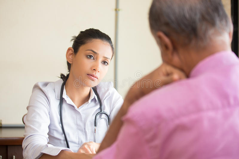 White coat anxiety. Closeup portrait, patient talking serious conversation to healthcare professional, isolated indoors background royalty free stock photography