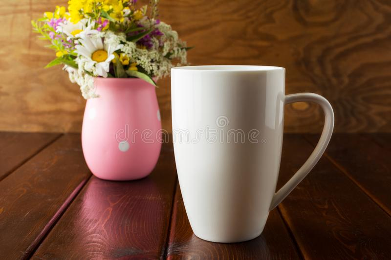 White coffee cappuccino mug rustic mockup with wildflowers in pi royalty free stock photos