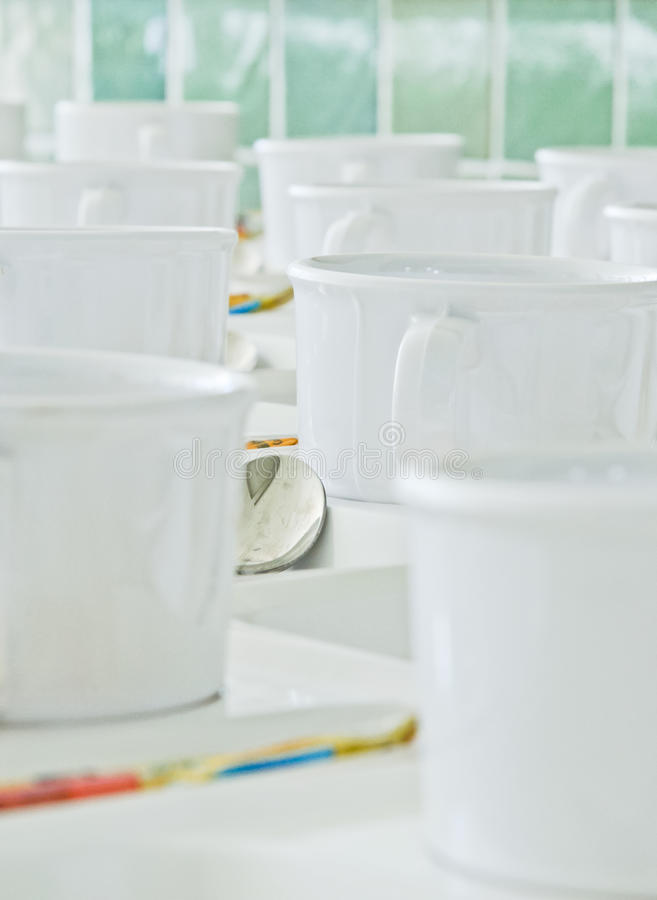 White coffee cup. Arranged in a row in front of the meeting rooms royalty free stock photos
