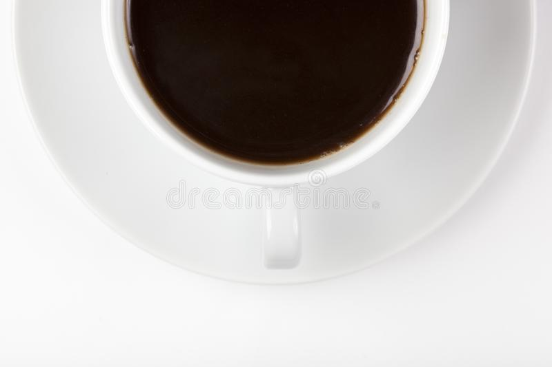 A white coffee cup with brown coffee stock photo