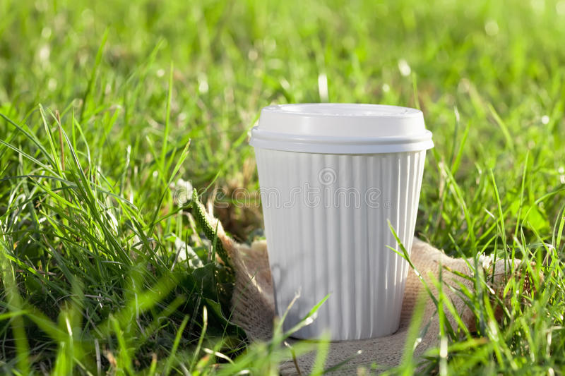 Download A White Coffee Cup In The Grass Stock Image - Image: 10865267