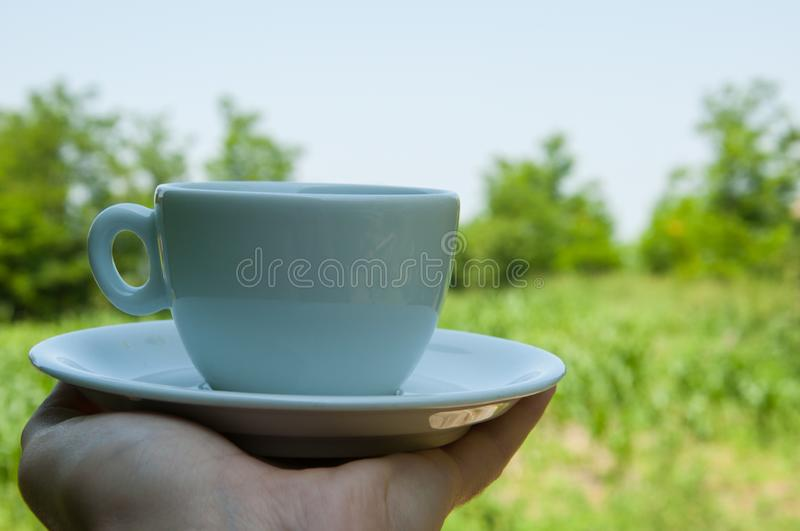 White coffee cup in hand in nature.Coffee time. Natural drink morning vintage breakfast mug hot table espresso wooden fresh aroma taste bean brown cafe closeup stock photo