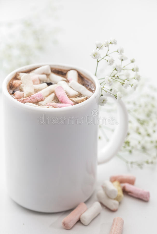 White coffee Cup with marshmallows and flowers stock illustration